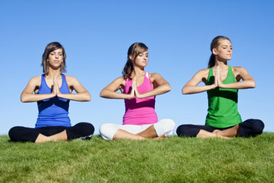 women meditating outdoors